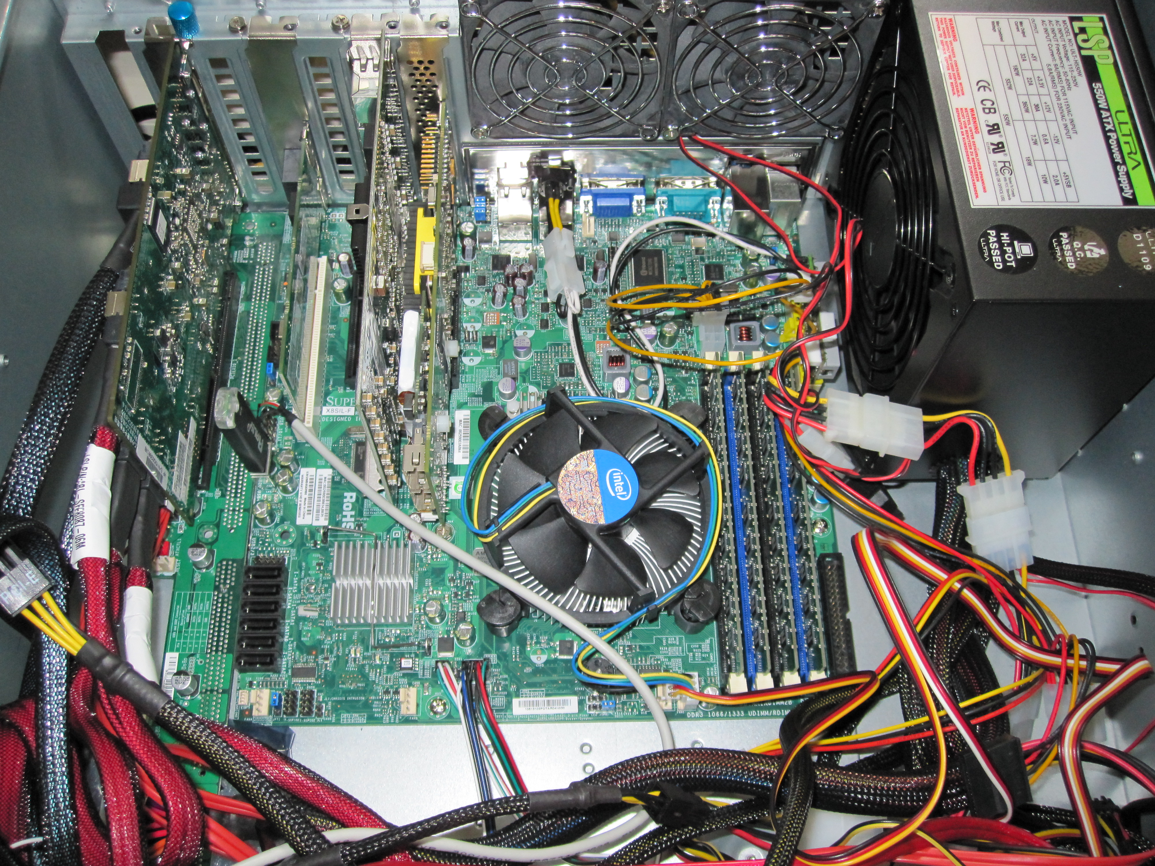 Supermicro X8SIL-F next to the HP-SAS Expander and PCMIG setup with both power supplies