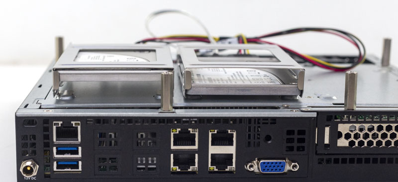 Supermicro AS E301 9D 8CN4 Storage Area With Two Intel SSDs Rear View