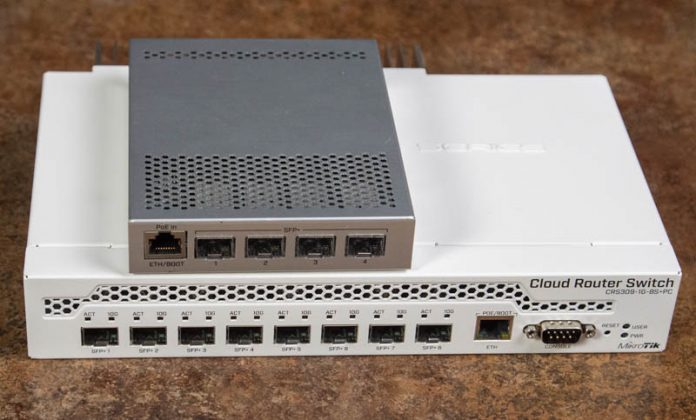 MikroTik CRS305 Atop CRS309 Front View