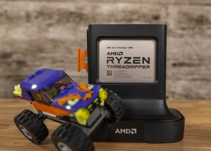 AMD Ryzen Threadripper 3990X Front In Package With Lego Monster Truck